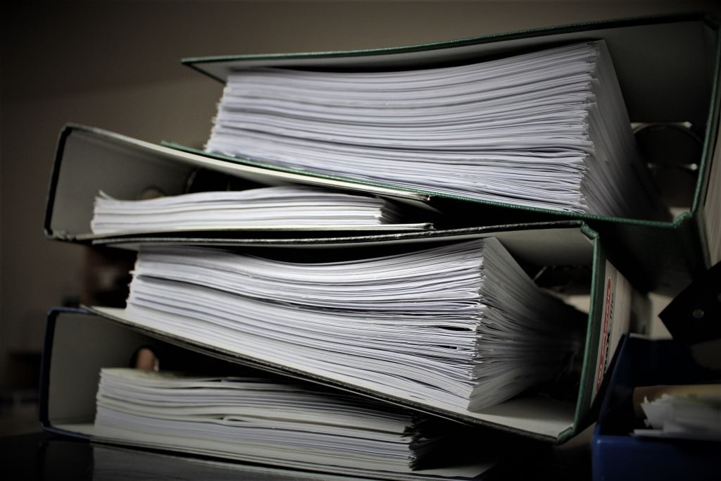 stack of binders filled with tax documents